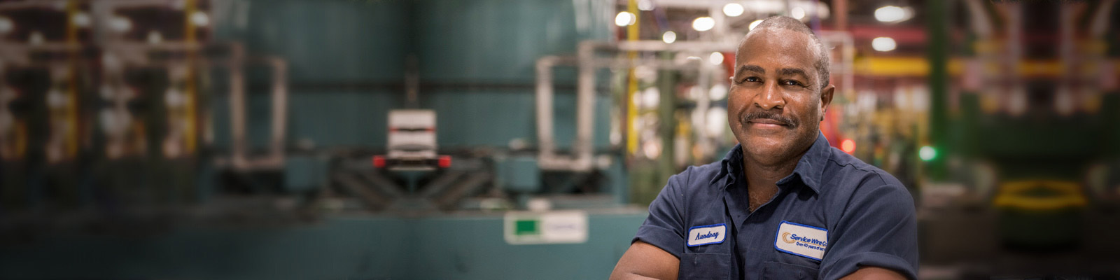 Service Wire Company employee posing for the camera at the Houston manufacturing facility