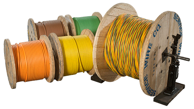 ServicePro-X Single Conductors in Orange, Brown, Yellow, Green sitting next to a reel of ServicePlex, an assembly of Service Wire conductors twisted to create a consistent, uniform construction